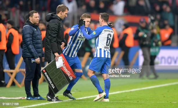 left coach Pal Dardai and right Maximilian Mittelstaedt and Vladimir Darida of Hertha BSC during the first Bundeliga game between Bayer 04 Leverkusen...