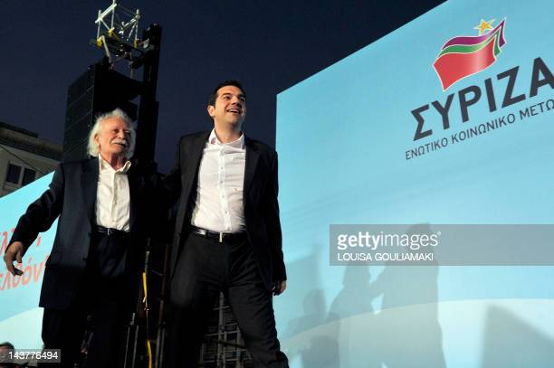 Left Coalition Party leader Alexis Tsipras and Manolis Glezos a resistance hero politician and writer greet the crowd prior to a speech during...