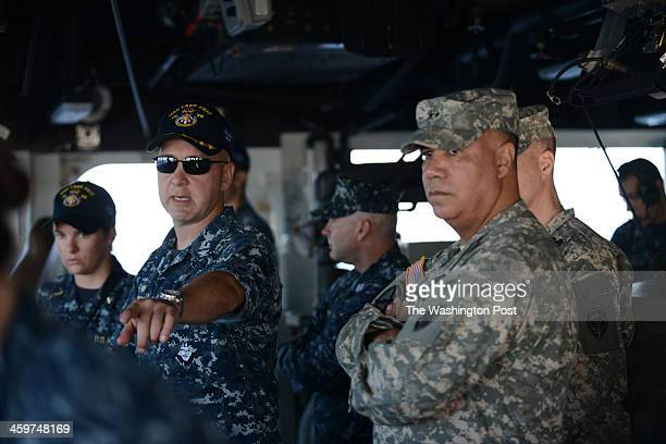 Left Commanding Officer John Banigan USS Lake Erie speaks to right Chief of Staff US Pacific Command Major General Anthony Crutchfield on board the...