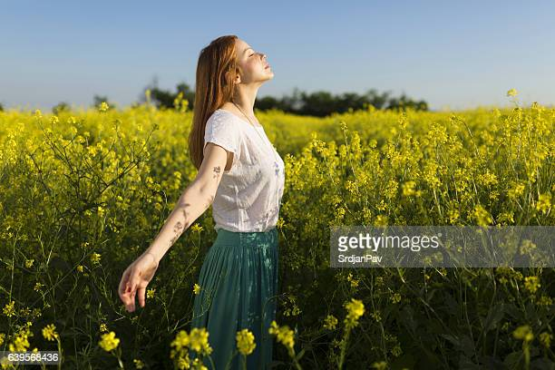 left daydreaming - redhead girl stock photos and pictures