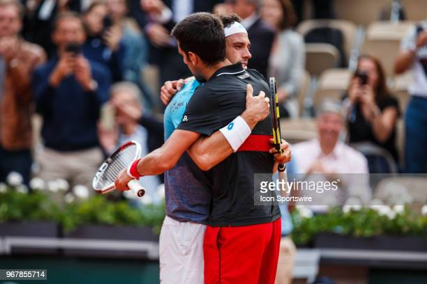 left embraces NOVAK DJOKOVIC after Zverev upset Djokovic during day ten match of the 2018 French Open 2018 on June 5 at Stade RolandGarros in Paris...
