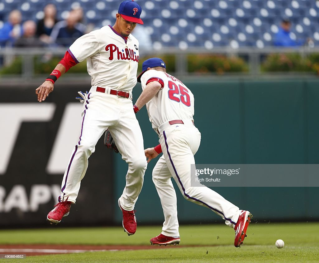Left fielder Aaron Altherr #40 and third baseman Cody Asche #25 of the Philadelphia Phillies avoid a collision as they chase down a foul ball hit by Kirk Nieuwenhuis #9 of the New York Mets during the fourth inning of a MLB game at Citizens Bank Park on October 1, 2015 in Philadelphia, Pennsylvania. The Phillies defeated the Mets 3-0.