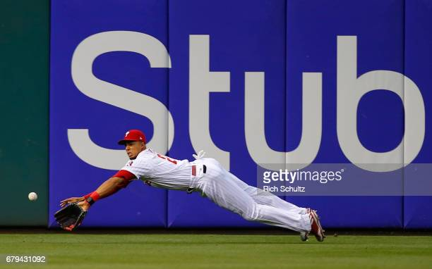 Left fielder Aaron Altherr of the Philadelphia Phillies dives but can't make a catch on a ball hit by Jayson Werth of the Washington Nationals for a...