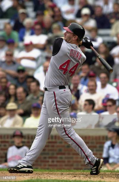 Left fielder Adam Dunn of the Cincinnati Reds swings at the pitch during the MLB game against the Chicago Cubs on September 26 2002 at Wrigley Field...