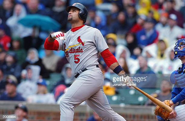 Left fielder Albert Pujols of the St Louis Cardinals watches as his grand slam home run flys out of the park during the game against the Chicago Cubs...