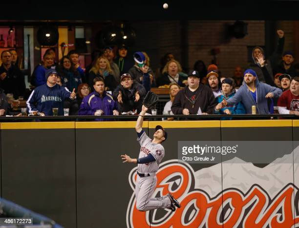 Left fielder Alex Presley of the Houston Astros makes leaping catch on a ball off the bat of Justin Smoak of the Seattle Mariners to end the second...