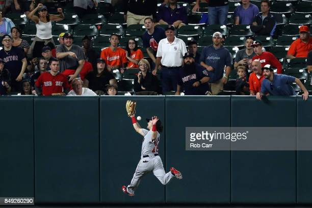 Left fielder Andrew Benintendi of the Boston Red Sox misses a RBI double hit by Austin Hays of the Baltimore Orioles in the fifth inning at Oriole...