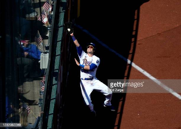 Left fielder Andrew Benintendi of the Kansas City Royals catches a foul ball off the bat of Leody Taveras of the Texas Rangers in the first inning on...