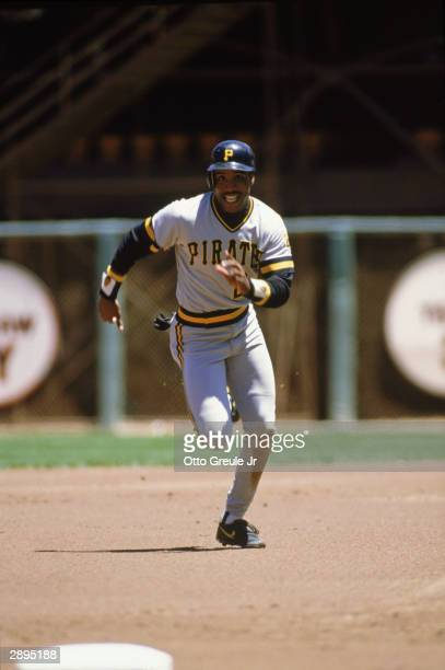 Left fielder Barry Bonds of the Pittsburgh Pirates runs to third base during the game against the San Francisco Giants at Candlestick Park in 1989 in...
