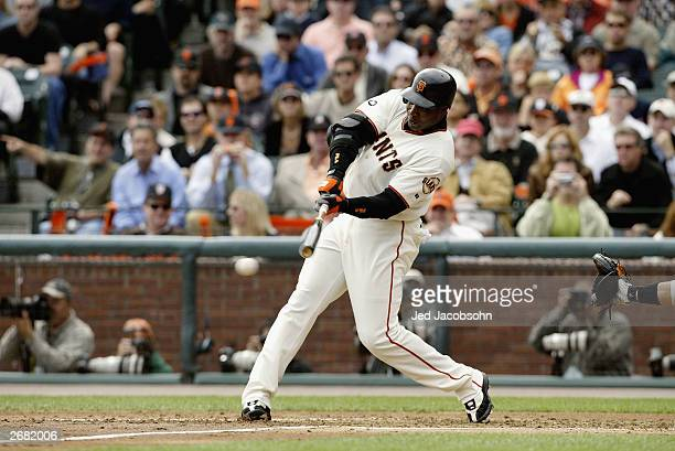 Left fielder Barry Bonds of the San Francisco Giants hits a double against the Florida Marlins during the first inning of Game 2 of the 2003 National...