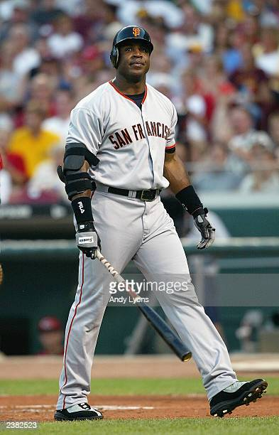 Left fielder Barry Bonds of the San Francisco Giants walks back to the dugout after striking out during the National League game against the...