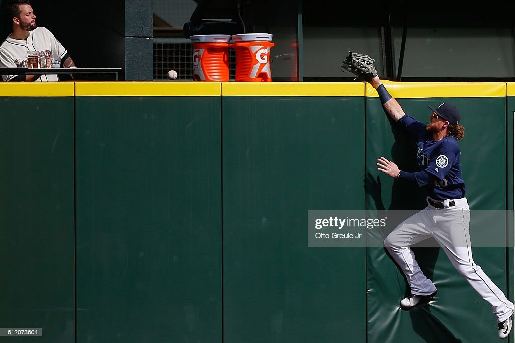 Left fielder Ben Gamel #16 of the Seattle Mariners leaps at the wall for a home run ball off the bat of Stephen Vogt of the Oakland Athletics in the first inning at Safeco Field on October 2, 2016 in Seattle, Washington. The Athletics defeated the Mariners 3-2.