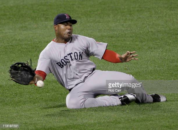 Left fielder Carl Crawford of the Boston Red Sox one hops a single by Vladimir Guerrero of the Baltimore Orioles during the fifth inning at Oriole...