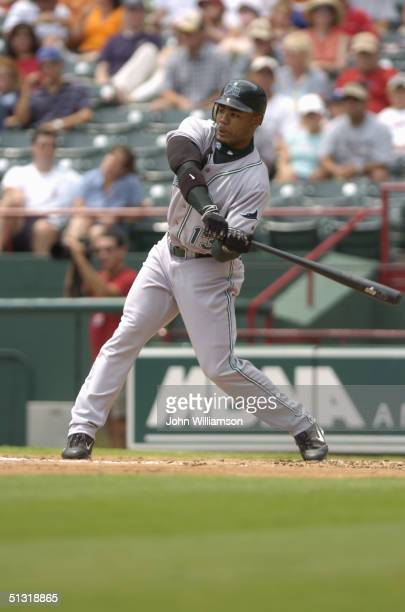 Left fielder Carl Crawford of the Tampa Bay Devil Rays bats during the MLB game against the Texas Rangers at Ameriquest Field in Arlington on August...