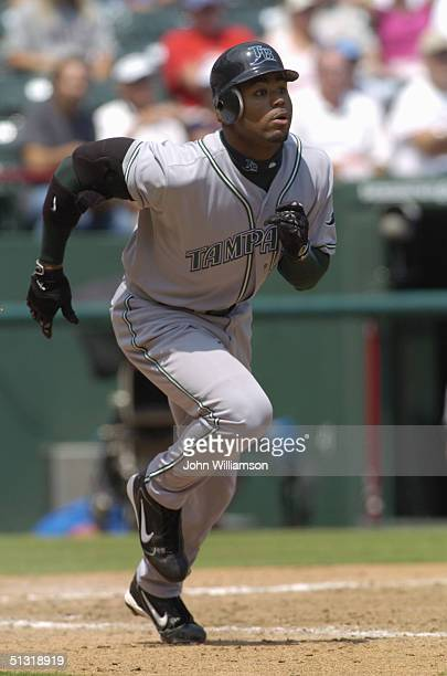 Left fielder Carl Crawford of the Tampa Bay Devil Rays runs to first base during the MLB game against the Texas Rangers at Ameriquest Field in...