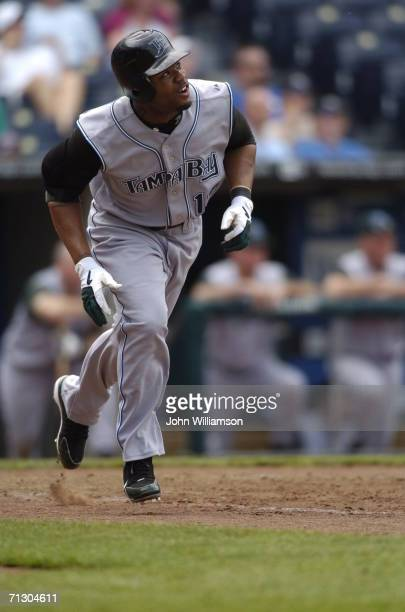 Left fielder Carl Crawford of the Tampa Bay Devil Rays runs to first base after hitting the ball during the game against the Kansas City Royals at...
