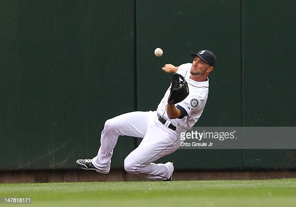 Left fielder Casper Wells of the Seattle Mariners catches a deep fly ball by Adam Jones of the Baltimore Orioles at Safeco Field on July 3 2012 in...