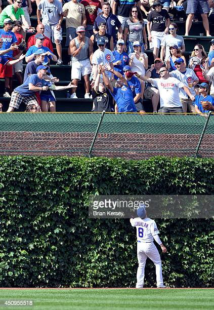 Left fielder Chris Coghlan of the Chicago Cubs watches as a threerun home run hit by Jordy Mercer of the Pittsburgh Pirates sails into the bleachers...