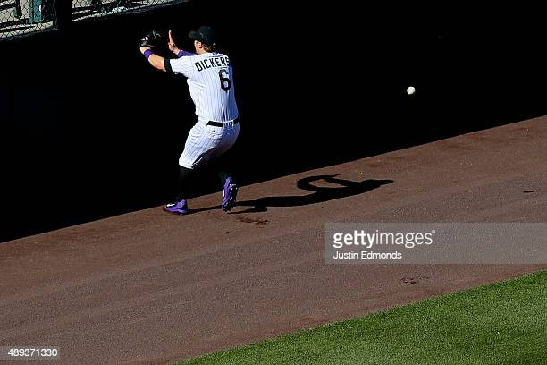 Left fielder Corey Dickerson of the Colorado Rockies lets an RBI double off the wall get past him off the bat of Justin Upton of the San Diego Padres...