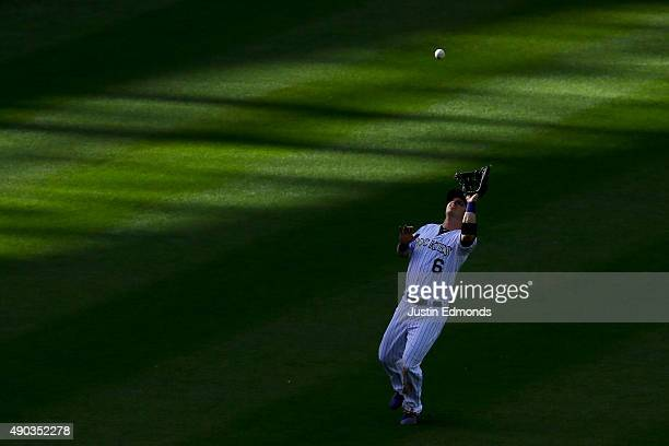 Left fielder Corey Dickerson of the Colorado Rockies makes a catch on a ball off the bat of Jimmy Rollins of the Los Angeles Dodgers for the second...