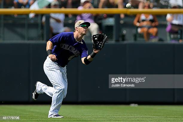 Left fielder Corey Dickerson of the Colorado Rockies makes a catch for the third out of the fourth inning against the Los Angeles Dodgers at Coors...