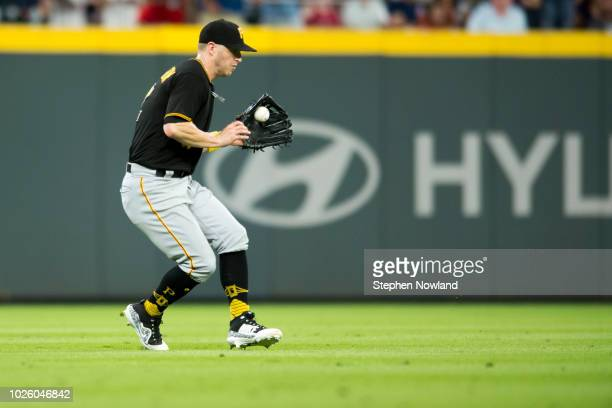 Left fielder Corey Dickerson of the Pittsburgh Pirates handles a single during the 8th inning at SunTrust Park on September 1 2018 in Atlanta Georgia