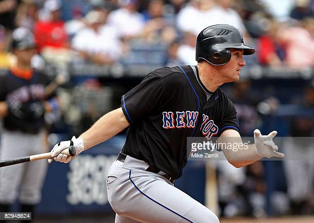 Left fielder Daniel Murphy of the New York Mets follows through on a swing during the game against the Atlanta Braves at Turner Field on September...
