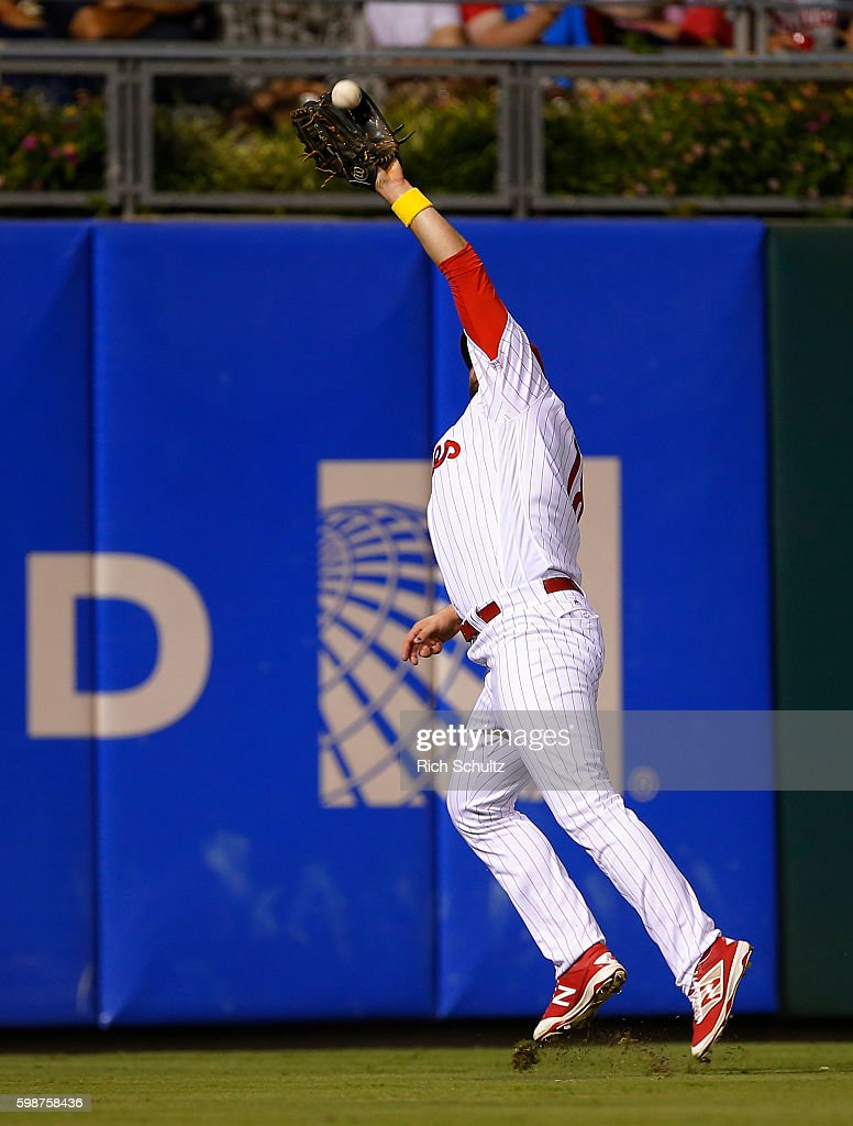 Left Fielder Darin Ruf #18 of the Philadelphia Phillies jumps to make a catch on a ball hit by Jace Peterson #8 of the Atlanta Braves during the fourth inning of a game at Citizens Bank Park on September 2, 2016 in Philadelphia, Pennsylvania. The Barves defeated the Phillies 8-4.