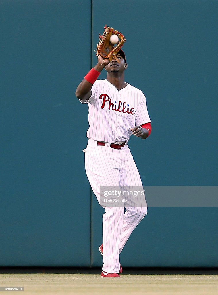 Left fielder Domonic Brown #9 of the Philadelphia Phillies makes a catch on a fly ball hit by Miguel Olivo #21 of the Miami Marlins during the second inning in a MLB baseball game on May 4, 2013 at Citizens Bank Park in Philadelphia, Pennsylvania. The Marlins defeated the Phillies 2-0.