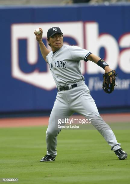 Left fielder Hideki Matsui of the New York Yankees throws the ball into the infield during the game against the Los Angeles Dodgers on June 19, 2004...