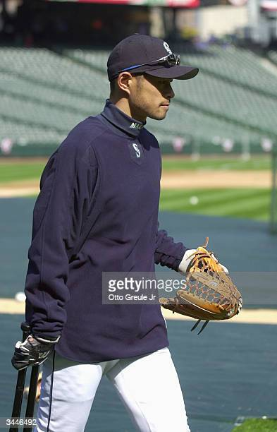 Left fielder Ichiro Suzuki of the Seattle Mariners walks around with his glove before the game against the Anaheim Angels on April 6 2004 at Safeco...