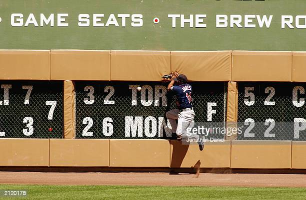 Left fielder Jacque Jones of the Minnesota Twins goes after the ball during the interleague game against the Milwaukee Brewers on June 22 2003 at...