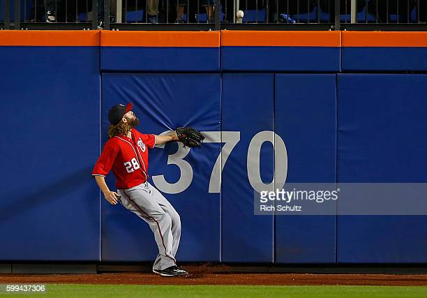 Left fielder Jayson Werth of the Washington Nationals hits the wall as a ball hit by Jay Bruce of the New York Mets goes over for a two run home run...