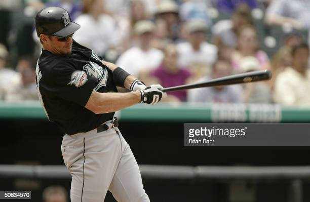 Left fielder Jeff Conine of the Florida Marlins takes a swing during the game against the Colorado Rockies at Coors Field on April 28 2004 in Denver...
