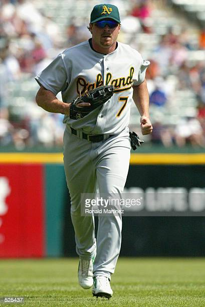 Left fielder Jeremy Giambi of the Oakland Athletics jogs to the dugout during the MLB game against the Texas Rangers at The Ballpark in Arlington...