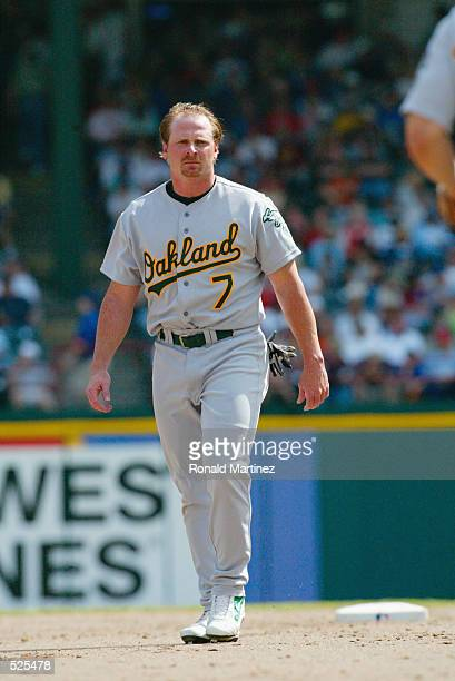 Left fielder Jeremy Giambi of the Oakland Athletics walks on the infield between innings during the MLB game against the Texas Rangers at The...