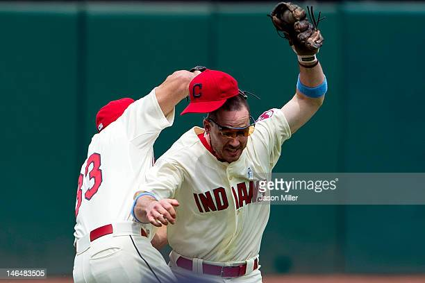 Left fielder Johnny Damon and third baseman Jack Hannahan of the Cleveland Indians run into each other while making a catch during the second inning...