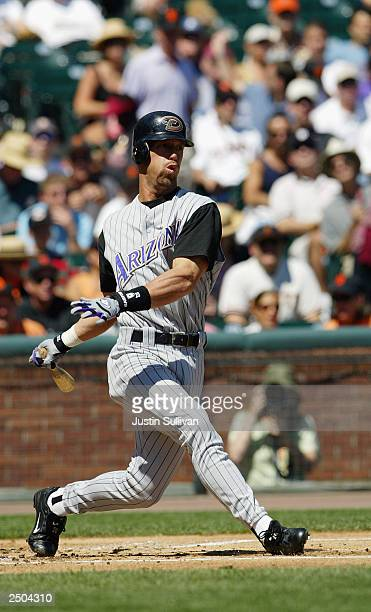 Left fielder Luis Gonzalez of the Arizona Diamondbacks swings at the pitch during the game against the San Francisco Giants at Pacific Bell Park on...