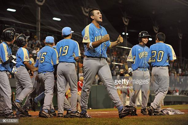 Left fielder Luke Ramirez of the West celebrates his team's victory against the Southeast in the US semifinal at Lamade Stadium on August 27 2009 in...