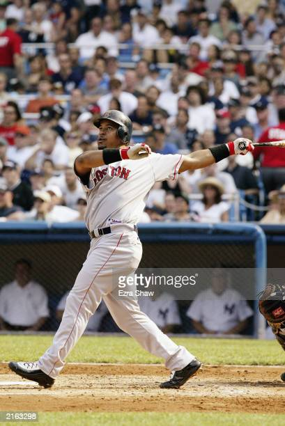 Left fielder Manny Ramirez of the Boston Red Sox hits a two-run home run to give the Red Sox a 5-2 lead in the third inning against the New York...