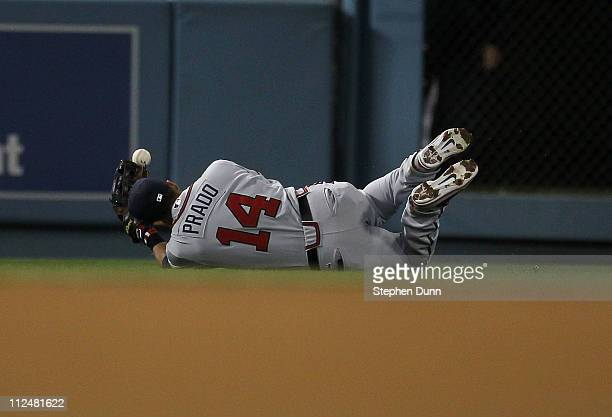 Left fielder Martin Prado of the Atlanta Braves loses the ball as he makes a diving attempt to catch a single hit by Casey Blake of the Los Angeles...