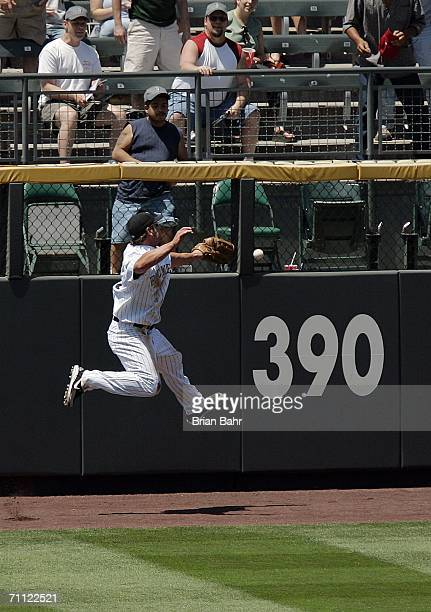 Left fielder Matt Holliday of the Colorado Rockies fails to catch a deep fly ball in the third inning against the Florida Marlins on June 4 2006 at...
