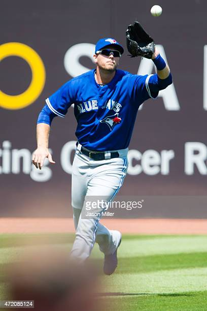 Left fielder Michael Saunders of the Toronto Blue Jays catches a fly ball hit by Jose Ramirez of the Cleveland Indians during the first inning...