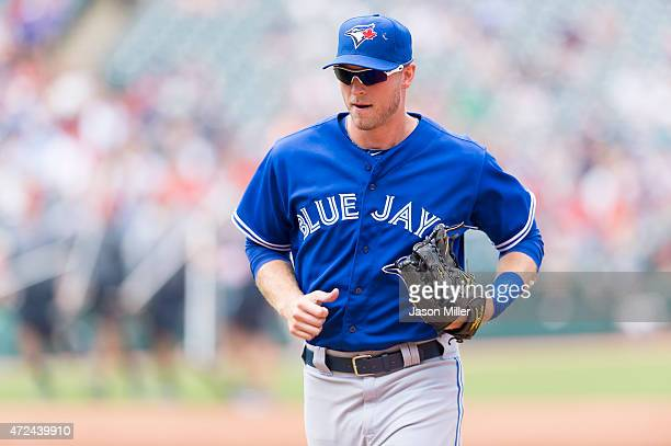 Left fielder Michael Saunders of the Toronto Blue Jays runs off the field after the end of the third inning against the Cleveland Indians at...