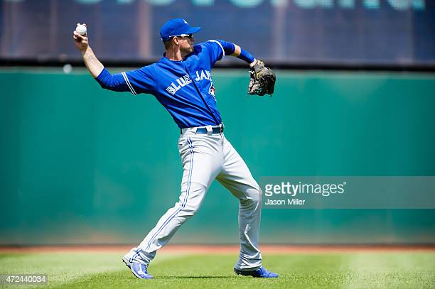 Left fielder Michael Saunders of the Toronto Blue Jays warms up prior to the second inning against the Cleveland Indians at Progressive Field on May...