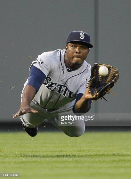 Left fielder Mike Wilson of the Seattle Mariners catches a ball hit by Nick Markakis of the Baltimore Orioles for an out during the fourth inning at...