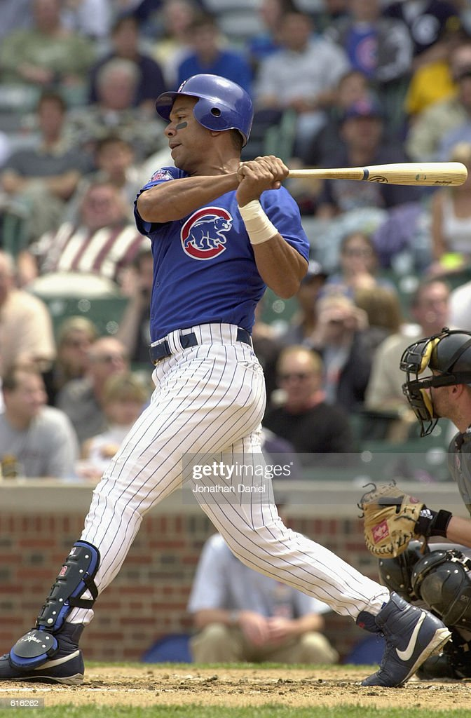 Left fielder Moises Alou #18 of the Chicago Cubs swings at the pitch during the MLB game against the Pittsburgh Pirates at Wrigley Field in Chicago, Illinois on May 23, 2002. The Cubs won 11-6.