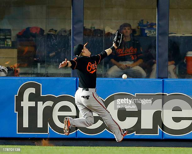 Left fielder Nate McLouth of the Baltimore Orioles can't get to a flyable double hit by Mark Reynolds of the New York Yankees scoring Curtis...