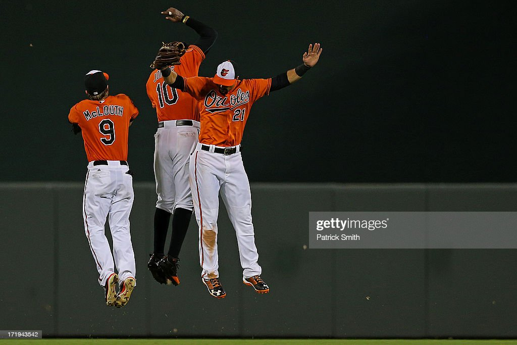 Left fielder Nate McLouth #9 of the Baltimore Orioles, center fielder Adam Jones #10 and right fielder Nick Markakis #21 celebrate after defeating the New York Yankees at Oriole Park at Camden Yards on June 29, 2013 in Baltimore, Maryland. The Baltimore Orioles won, 11-3.