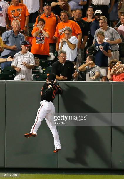 Left fielder Nate McLouth of the Baltimore Orioles misses a tworun home run hit by Steve Pearce of the New York Yankees during the fourth inning at...